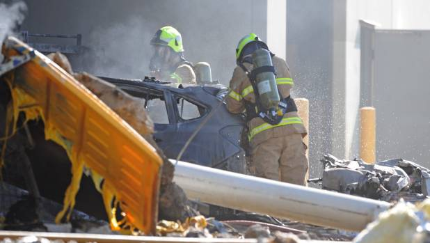 Emergency services personnel are seen at the scene of a plane crash in Melbourne, Australia.
