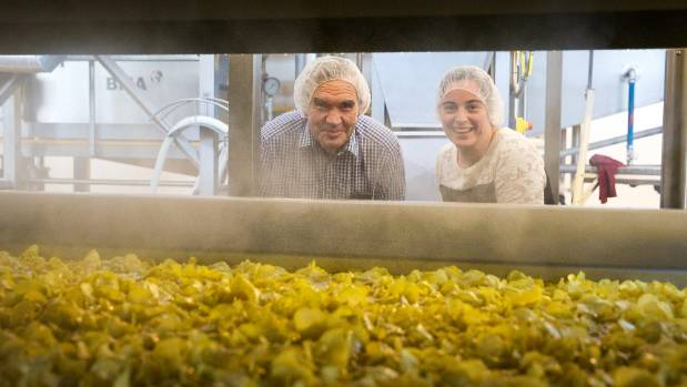 Heartland Potato Chips owner Raymond Bowan and his daughter, general manager Charlotte Bowan, keep an eye on their new ...