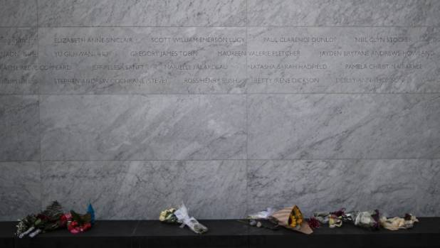 Bouquets left at the memorial, which is 112.5 metres long and made of concrete, clad in Italian marble.