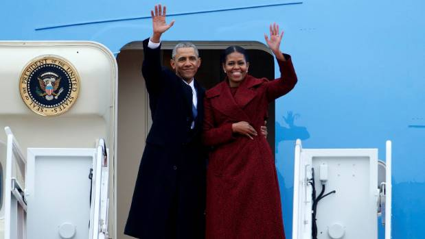 Barack Obama waves with his wife Michelle as they fly out of Washington on a presidential plane for the last time in January.