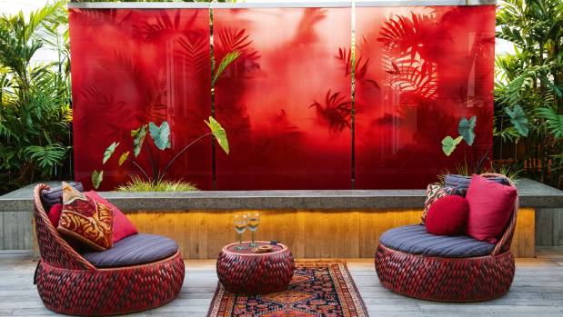 Loena Wilson McCormack bought the Domo furniture soon after the dramatic red glass wall had been installed.