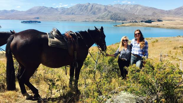 Reese Witherspoon checks out Lake Tekapo during a horse trek with Mackenzie Alpine Horse Trekking guide Ginny Sutton.