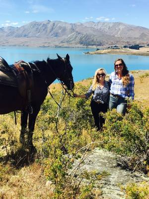 Hollywood star Reese Witherspoon checks out Lake Tekapo during a horse trek with Mackenzie Alpine Horse Trekking guide ...