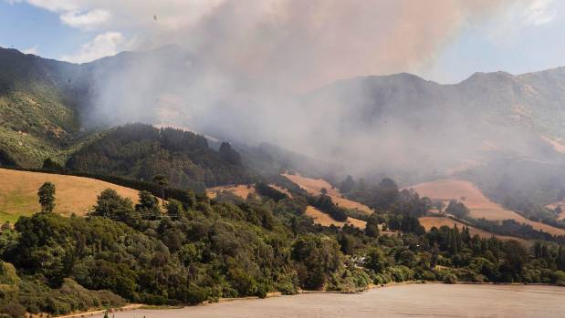 Fire burning down towards Governors Bay from Summit Rd. Ohinetahi homestead can be seen in the bottom of the image.