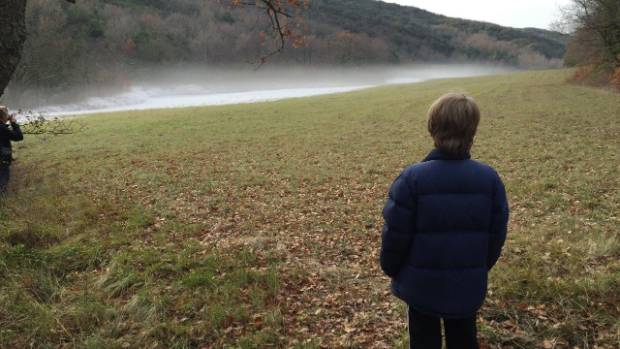 On a day walk in the local countryside, Tom (12) studies the frost haze hanging over the field.