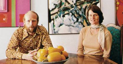 Warwick and Kitty Brown photographed for Art New Zealand 1978. Artworks on wall behind them by Don Driver, Robert Ellis ...