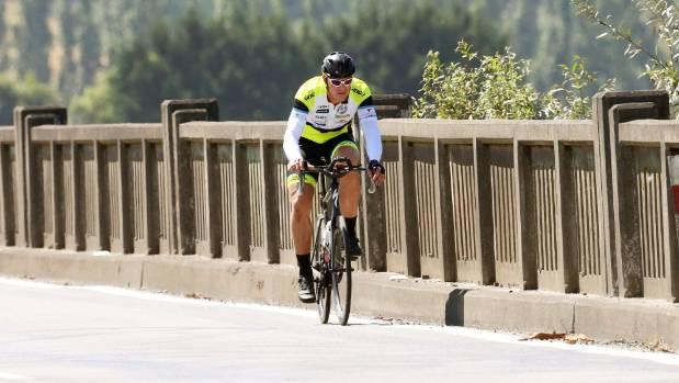 Craig Harper looks focused as he crosses the Wairau River bridge on State Highway 1 outside Blenheim on Wednesday.