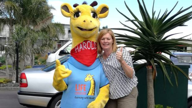 Michelle Kidd of Life Education Counties Manukau and the trust's popular mascot Harold the Giraffe.