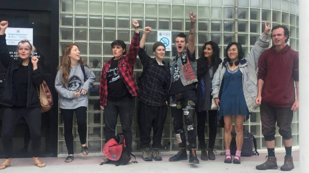 Members of Peace Action Wellington celebrate after charges stemming from a protest at an arms industry conference were ...