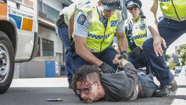 A Peace Action Wellington protester arrested outside the TSB Arena.