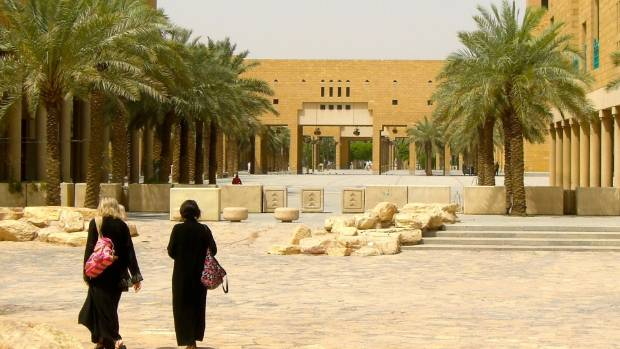 Women in Saudi Arabia, including foreigners, are required to wear an abaya (long black cloak) that covers the entire ...