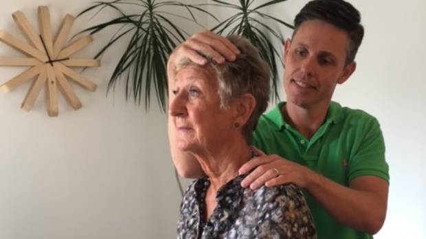 Osteopath Andrew Gibson works with a patient in his Herne Bay clinic.