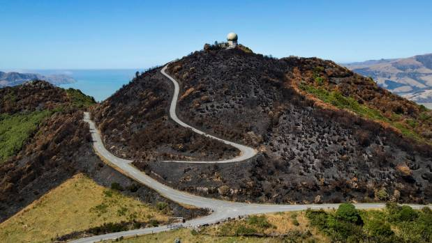 Firefighters will remain on the Port Hills for up to four weeks, dousing hot spots. Photos from Christchurch City ...