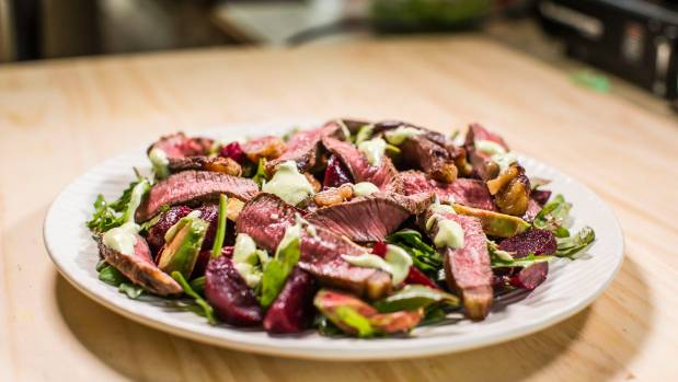 Rare beef salad with avocado and beetroot.