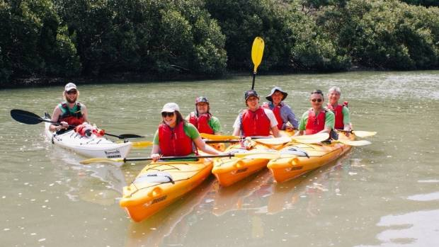 Green party members kayak Lucas Creek as a part of raising awareness for the Swimmable Rivers campaign.