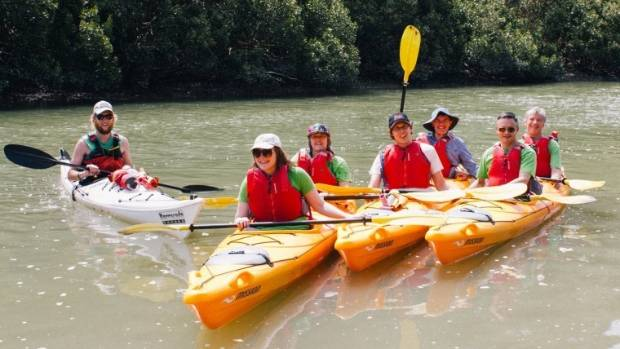 Green party members kayak Lucas Creek as a part of raising awareness for the party's Swimmable Rivers campaign.