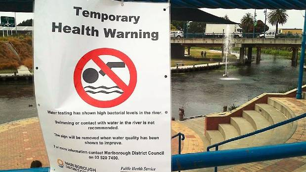 A health warning at the Taylor River in January this year.