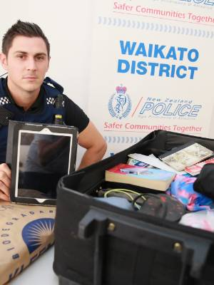 Tactical Crime Unit Constable Gareth Sanson with the Drysdales' recovered luggage and goods, including two priceless ...