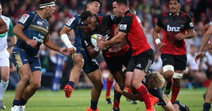 Crusaders right wing Seta Tamanivalu, with assistance from midfielder Ryan Crotty (right), tries to step through the ...