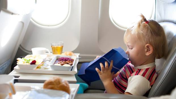 When you're booking your flight, order a special meal - vegetarian, kosher, halal - whatever. Those meals are usually ...