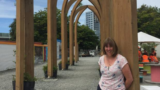 Anne Cunningham, co-director of Te Putahi, hopes to pave under the wooden arches using pavers recycled from Victoria Square.