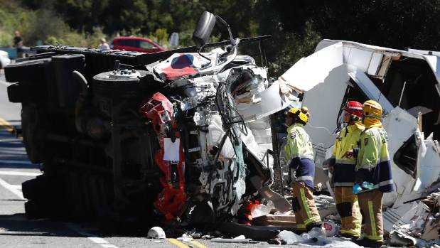 The crumpled wrecks of the Isuzu truck and caravan towed by a Toyota Prado. The drivers of both vehicles died at the scene.