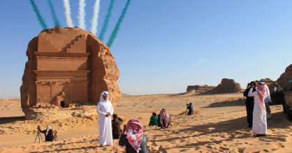 Saudi visitors watch an aerial flying display over Mada'in Saleh, a UNESCO World Heritage Site, in Mada'in Saleh.