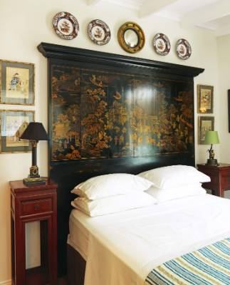 The Shanghai Queen room in this Puhoi homestead was designed with the 1920s style in mind and this headboard rounds it ...