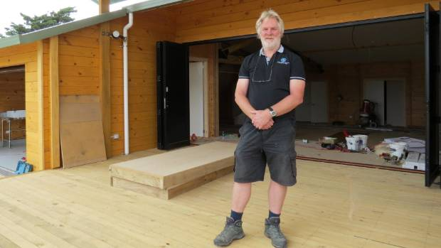 The Pines and Kairaki Beaches community hall designer Tim Stephenson is pleased with the hall's progress.