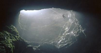 A caver looks like a tiny spider as he descends into Harwoods Hole in 1993.