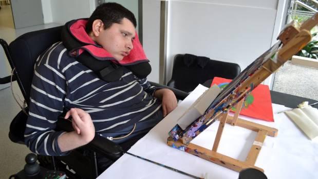 Yuri Kingsley-Smith working on an art piece.