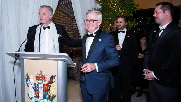 New Zealand Ambassador to the US Tim Groser, in blue, mixes with Washington DC high-fliers at a gala do put on by the ...