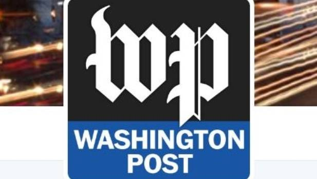 """The Washington Post has added a new phrase beneath its online masthead: """"Democracy Dies in Darkness""""."""