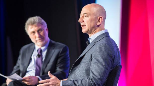At a forum last year, Washington Post Executive Editor Martin Baron, left, interviews Amazon.com founder and Post owner ...
