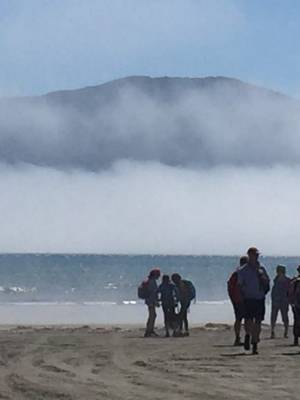 A sea fog rolls in on to Paraparaumu Beach, with Kapiti Island looming in the background.