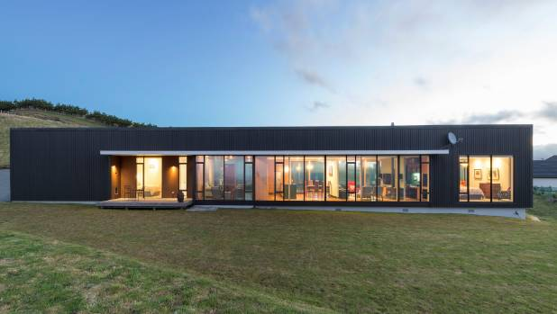 The house sits on a 12,722 square-metre rurual site, with the building itself acting as a wind break for the strong ...