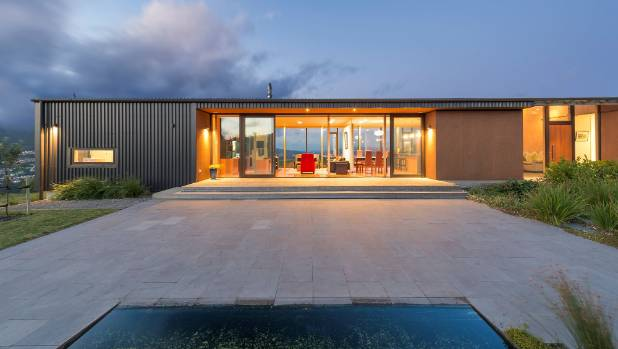 Full-height glazing on both sides of this house in Tawa, Wellington, allow the views from the living area to be ...