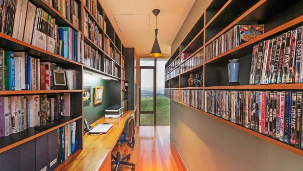 There is also a library and study space with extensive shelving.