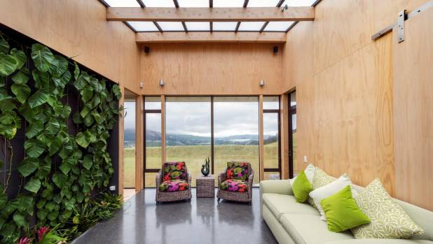 A green living wall and large skylight are key features of the entry lobby, which is a refuge on windy days.