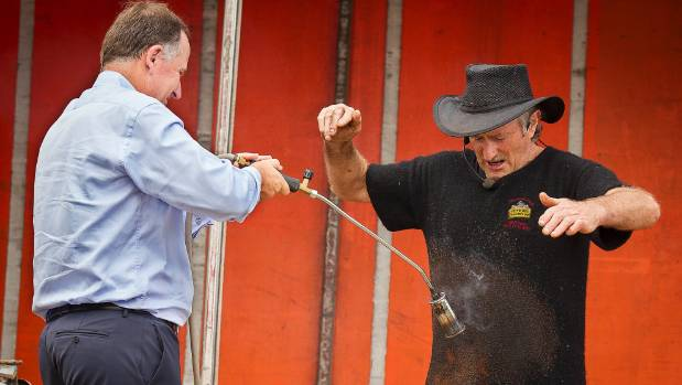 Famous for horsing around: Key sets the Woolman, Billy Black, alight at the Helensville A&P.