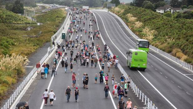 Hundreds of people take the opportunity to walk along the new expressway prior to its opening in February.
