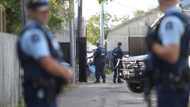 Police carry out a raid a Rebels gang pad in Christchurch in 2016.