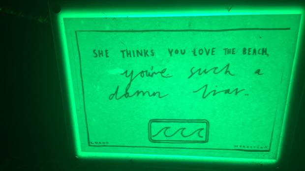 Potential lyrics lit up in green in Lorde's Herne Bay location.