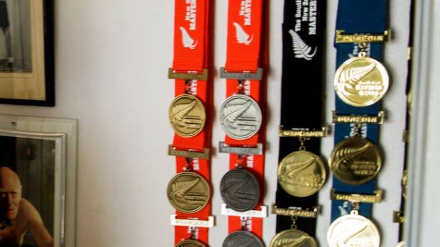 Far from giving up, Michael has two spare nails, left, on his medals board waiting to receive the next set of medals.