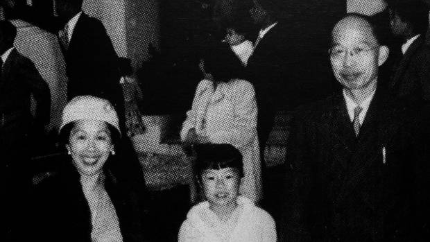 Young Helene and her parents, Willie and Dolly Wong, after a wedding, 1950s.