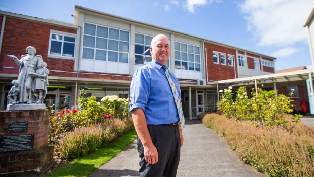 School principal Martin Chamberlain said he wasn't banning phones, but he was  limiting their use.