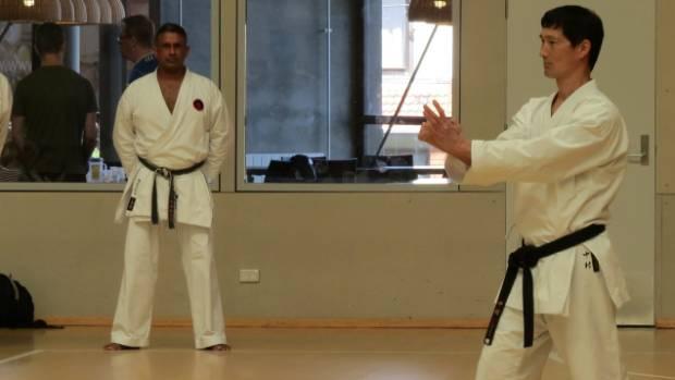 Sensei Rajesh watches World Chief Instructor Sensei Nakamura  demonstrate the finer details of Senior Goju Ryu Kata and ...