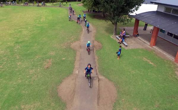 Pupils navigate the small humps in the track.
