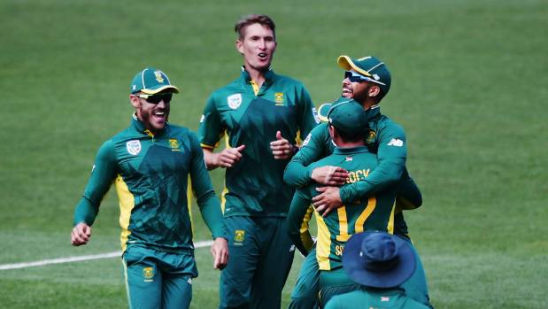 JP Duminy and Proteas teammates celebrate the wicket of Black Caps allrounder Mitchell Santner.