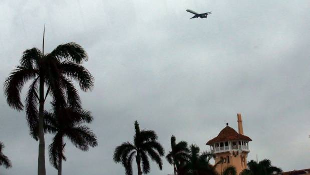 A commercial plane flies over Donald Trump's Mar-a-Lago estate.
